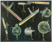 Various substances fluorescing in vacuum tubes of different shapes. Chromolithograph, Leipzig 1903.