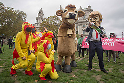 Licensed to London News Pictures. 24/10/2020. London, UK. Protestors in Parliament Square demonstrate against the possible erosion of food standards in a future trade deal between the USA and the UK. The US Election between Donald Trump and Joe Biden will take place on Tuesday 3 November 2020. Photo credit: Marcin Nowak/LNP