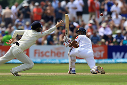 November 7, 2018 - Galle, Sri Lanka - England cricketer Rory Burns  (L) dives to catch the ball as Sri Lankan cricket captain Dinesh Chandimal looks on during the 2nd day's play of the first test cricket match between Sri Lanka and England at Galle International cricket stadium, Galle, Sri Lanka, on 7 Novemeber 2018. (Credit Image: © Tharaka Basnayaka/NurPhoto via ZUMA Press)