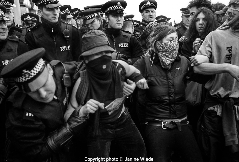Police and protesters clash by Excel Center during annual Arms Trade Fair. East London 2003