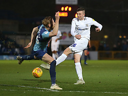 Wycombe Wanderers' Jason McCarthy (left) and Coventry City's Jordan Shipley battle for the ball