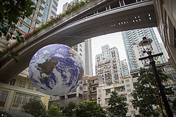 March 30, 2019 - Hong Kong, China - Earth Globe 'Gaia' by artist Luke Jerram set up to raise awaring about global warming seen in the Wan Chai district of Hong Kong Island. (Credit Image: © Guillaume Payen/SOPA Images via ZUMA Wire)