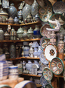 Artisanal handmade dishes and jugs for sale at a shop in the medina in Fes, Morocco