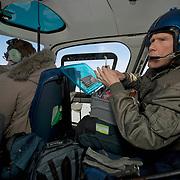 tSteve Amstrup, lead polar bear biologist for the USGS, prepares a dart that will be filled with Telazol, an imobilizing drug. Kaktovik, Alaska