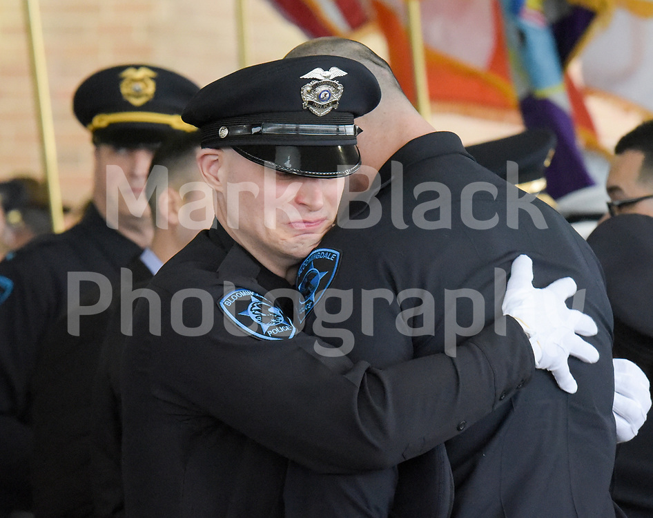 Bloomingdale Police officers mourn the passing  fellow Officer Raymond Murrell after a funeral service at Wheaton Bible Church in West Chicago.