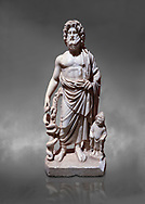 Roman statue of Asklepios. Marble. Perge. 2nd century AD. Inv no . Antalya Archaeology Museum; Turkey.  Against a grey background<br /> <br /> Asclepius was a hero and god of medicine in ancient Greek religion and mythology. .<br /> <br /> If you prefer to buy from our ALAMY STOCK LIBRARY page at https://www.alamy.com/portfolio/paul-williams-funkystock/greco-roman-sculptures.html . Type -    Antalya     - into LOWER SEARCH WITHIN GALLERY box - Refine search by adding a subject, place, background colour, museum etc.<br /> <br /> Visit our ROMAN WORLD PHOTO COLLECTIONS for more photos to download or buy as wall art prints https://funkystock.photoshelter.com/gallery-collection/The-Romans-Art-Artefacts-Antiquities-Historic-Sites-Pictures-Images/C0000r2uLJJo9_s0
