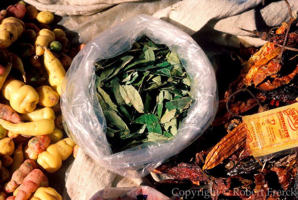 PERU, HIGHLAND, MARKETS Chincheros; selling coca leaves