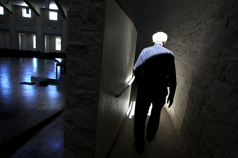 Father Timothy Gollob - aka Father Tim - walks through the brand new sanctuary at Holy Cross Catholic Church in south Dallas September 28, 2010.  He has been the church's priest for 41 years. Friday is his 76th birthday, and this weekend the church will hold the first Masses in the new sanctuary.  (Courtney Perry/The Dallas Morning News)
