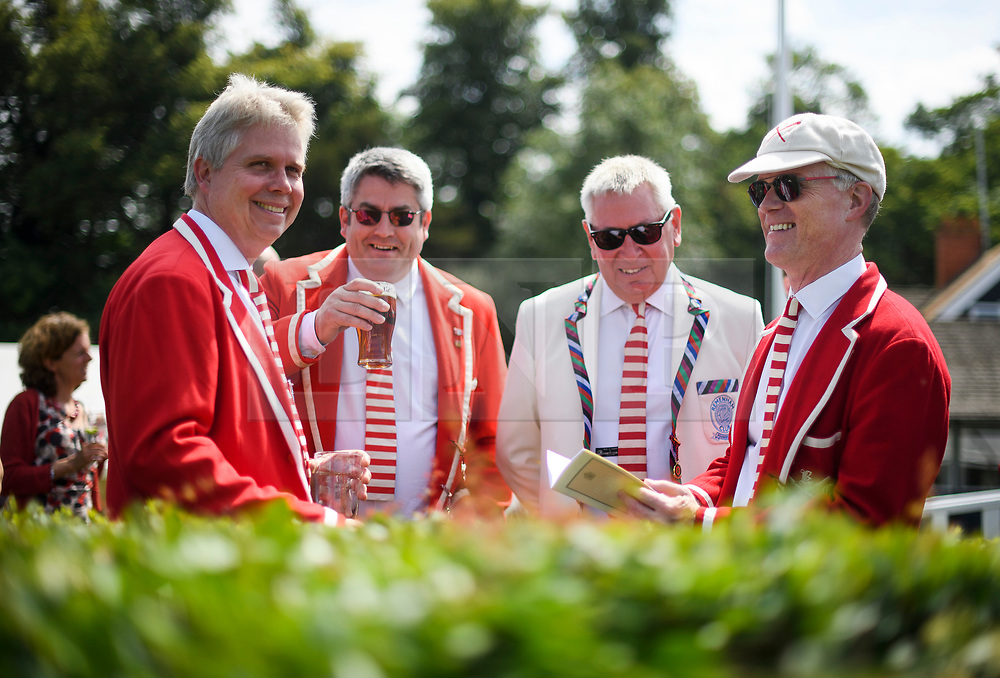 © Licensed to London News Pictures. 04/07/2018. Henley-on-Thames, UK. A group of men in rowing club colour jackets real on Day one of the Henley Royal Regatta, set on the River Thames by the town of Henley-on-Thames in England. Established in 1839, the five day international rowing event, raced over a course of 2,112 meters (1 mile 550 yards), is considered an important part of the English social season. Photo credit: Ben Cawthra/LNP