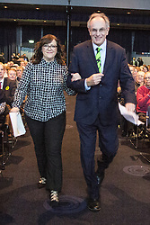© Licensed to London News Pictures . 05/02/2016 . Manchester , UK . LOUISE BOURS MEP and PETER BONE MP walk through arm in arm to the stage . Grassroots Out , anti-EU membership campaign event , at the Manchester Central Convention Centre . Photo credit : Joel Goodman/LNP