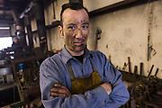 Blacksmith Frank Verga in a metal working shop in Charleston, SC