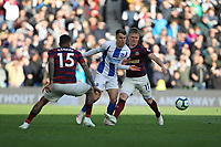 Football - 2018 / 2019 Premier League - Brighton and Hove Albion vs. Newcastle United<br /> <br /> Solly March of Brighton fights his way past Matt Ritchie of Newcastle United and Kenedy of Newcastle United during the Premier League match at The Amex Stadium Brighton  <br /> <br /> COLORSPORT/SHAUN BOGGUST