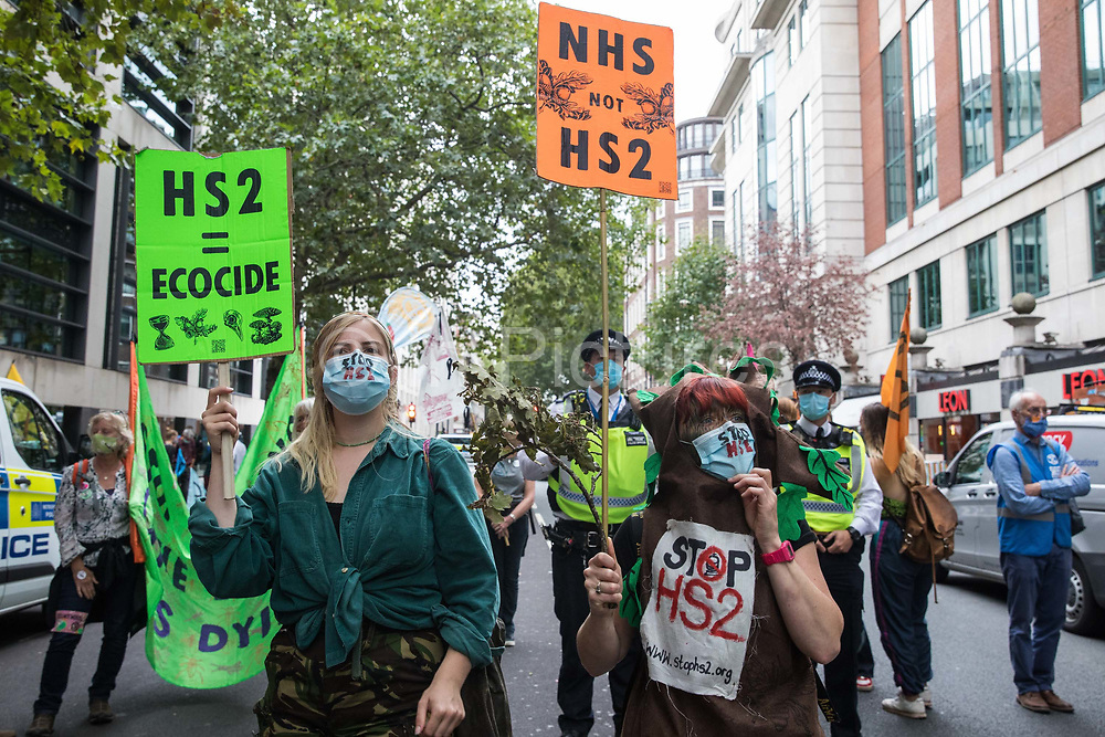 Activists from HS2 Rebellion, an umbrella campaign group comprising longstanding campaigners against the HS2 high-speed rail link as well as Extinction Rebellion activists, attend a protest outside the Department for Transport on 4 September 2020 in London, United Kingdom. Activists glued themselves to the doors and pavement outside the building and sprayed fake blood around the entrance during a protest which coincided with an announcement by HS2 Ltd that construction of the controversial £106bn high-speed rail link will now commence.