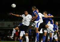 Photo: Rich Eaton.<br /> <br /> Hereford United v Leicester City. Carling Cup. 19/09/2006. Tamika Mkandawire, left, captain of Hereford goes for a header in the Leicester box