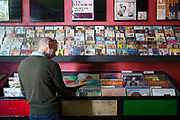 A man searching through vinyl at the Jamaican music shop People's Sound Records on the 26th March 2018 in Notting Hill, West London in the United Kingdom.