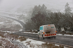 © Licensed to London News Pictures. 06/01/2021. Builth Wells, Powys, Wales, UK. After fresh snowfall motorists drive along the B4520 Brecon through a bleak wintry landscape on the Mynydd Epynt range near Builth Wells in Powys, Wales, UK. Photo credit: Graham M. Lawrence/LNP