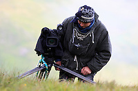Photographer in the field (model release 02/08/HTNP) Hohe Tauern National Park, Carinthia, Austria