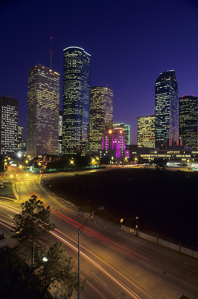 Stock photo of the downtown Houston skyline at night.