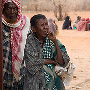 An elderly couple wait, expectantly, to receive their relief during the East African drought. Wajir, North Eastern Province, Kenya.