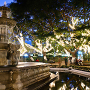 Parque Central (or Plaza Central), the main town square in Antigua Guatemala., at night. Famous for its well-preserved Spanish baroque architecture as well as a number of ruins from earthquakes, Antigua Guatemala is a UNESCO World Heritage Site and former capital of Guatemala.