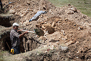 A grave digger works at Soma cemetery during the third day of the Soma mining disaster, as bodies continue to be recovered. An electrical fault caused an explosion in the shaft resulting in at least 282 workers being killed in the disaster. Soma, Western Turkey.