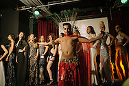 A male Zenne dancer performs infront of women lined up on stage as fellow contestants and hosts introduce them infront of the eager crowd at the Trans Beauty Pageant, organised by Angel of Turkey to raise awareness, break stereotypes and halp financially towards a shelter for Trans women in the city.