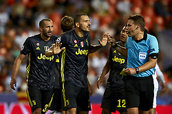 September 19, 2018 - Valencia, Spain - (L-R) Giorgio Chiellini, Leonardo Bonucci,Alex Sandro talk to the referee  Felix Brych during the Group H match of the UEFA Champions League between Valencia CF and Juventus at Mestalla Stadium on September 19, 2018 in Valencia, Spain. (Credit Image: © Jose Breton/NurPhoto/ZUMA Press)