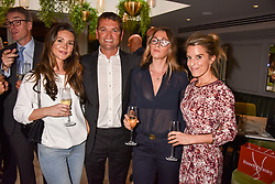 Left to right, Binkie Moorhead, Andrew Stembridge, Charlotte Moorhead and Emma Hartland-Mahon at a party to celebrate the launch of Hans' Bar & Grill, 11 Cadogan Gardens, Chelsea, London, England. 07 June 2018.