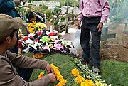 Incense is burned at a decorated gravesite, Sumpango Cemetary, Guatemala.
