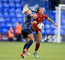 Liverpool Women's Leighanne Robe (right) and Manchester United Women's Kirsty Smith battle for the ball during the Continental Tyres Cup, Group Two North match at Prenton Park, Birkenhead.