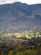A high-angle view of Arrowtown, Otago, New Zealand from the Zig Zags on the Crown Range Road, on an autumn day.