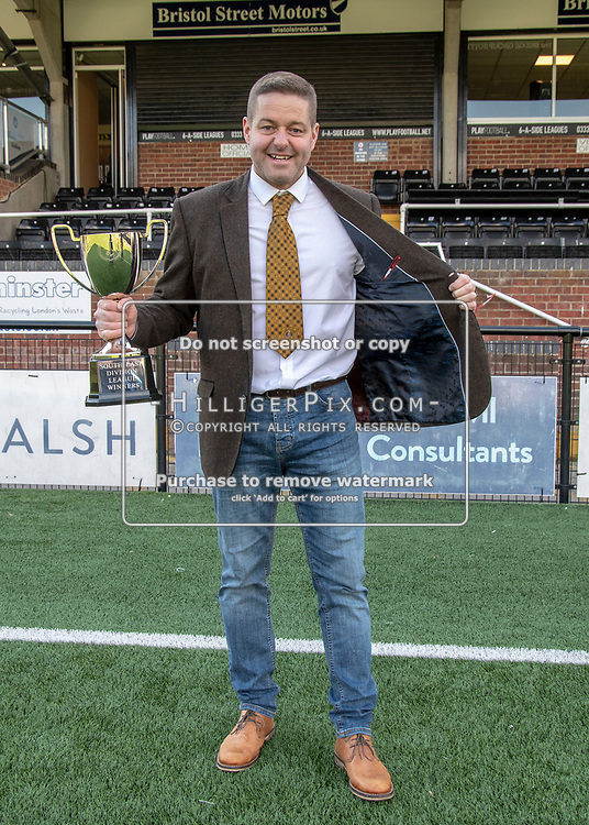 BROMLEY, UK - APRIL 13: Sam Wright with the cup and 'that' jacket after the Bostik League South East match between Cray Wanderers FC and Ashford United FC at Hayes Lane on April 13, 2019 in Bromley, UK. (Photo: Jon Hilliger)