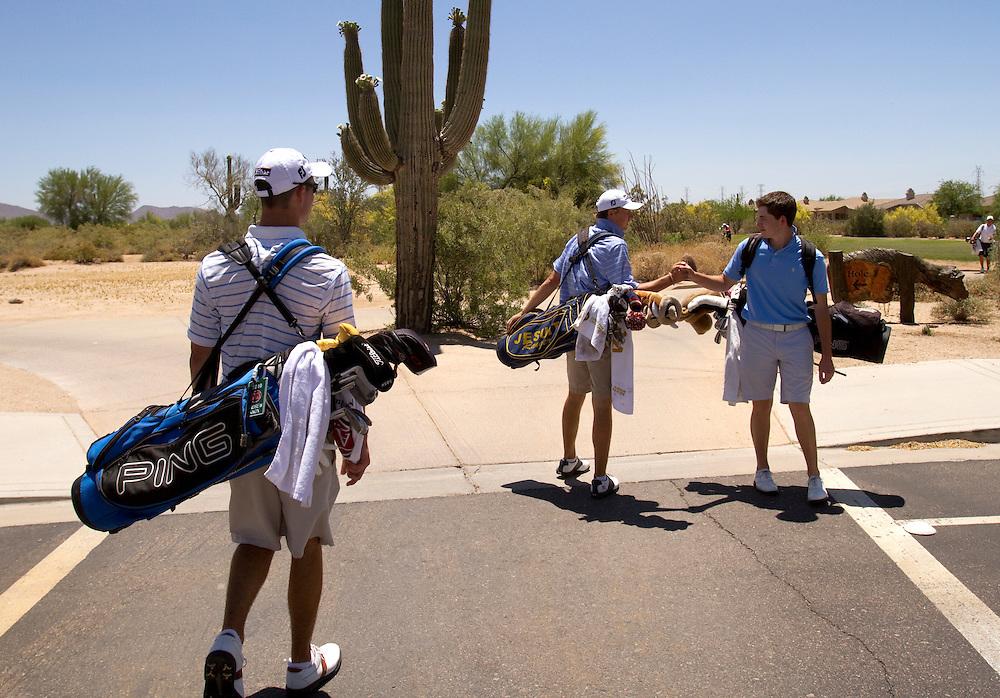 American Junior Golf Association player Jordan Spieth, center, greets a friend between holes at the Thunderbird International Junior tournament.