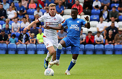 Siriki Dembele of Peterborough United in action with Josh Vela of Bolton Wanderers - Mandatory by-line: Joe Dent/JMP - 28/07/2018 - FOOTBALL - ABAX Stadium - Peterborough, England - Peterborough United v Bolton Wanderers - Pre-season friendly