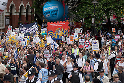 © Licensed to London News Pictures. LONDON, UK  30/06/11. Marchers crowd into the area around Westminster Central Hall where today's (Thursday) anti-cuts protest was due to finish.  Around 20,000 protesters take to the streets of London to demonstrate against government public sector cutbacks. Please see special instructions for usage rates. Photo credit should read Matt Cetti-Roberts/LNP