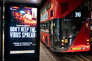 A government NHS National Heath Service advert at a bus stop displays the face of a Covid patient, urging Londoners to stay at home and to socially distance, outside the Royal Courts of Justice, on 2nd February 2021, in London, England.