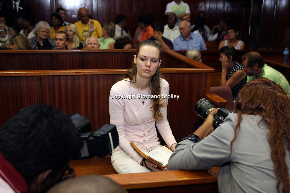 DURBAN - 13 March 2012 - Nicolette Lotter with her bible in the dock of Durban High Court faces press photographers after being convicted of the murder of her parents along with her brother Hardus Lotter and ex-boyfriend Mathew Naidoo (not in picture)..Picture: Giordano Stolley/ Allied Picture Press/ APP