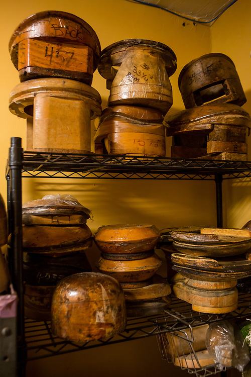 A collection of hat molds, including blocks for brims and crowns, and risers to make the crowns deeper.