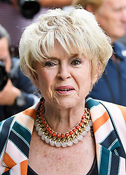 © Licensed to London News Pictures. 18/07/2018. London, UK. GLORIA HUNNIFORD arrives at the Rolls Building of the High Court in London where judges will deliver their decision on a claim by Sir Cliff Richard for damages against the BBC for loss of earnings. The 77-year-old singer is suing the corporation after his home in Sunningdale, Berkshire was raided following allegations of sexual assault made to Metropolitan Police. Photo credit: Ben Cawthra/LNP