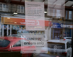 General views of Stirling City centre and shops during the Coronavirus outbreak, 18 March 2020<br /> <br /> Pictured: McDonalds sign in the window advising takeaway orders only<br /> <br /> Alex Todd | Edinburgh Elite media