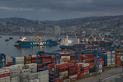 Container ships and containers in harbor, sea and city, Valparasio, Chile
