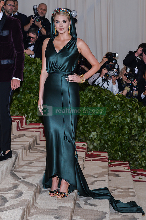 Kate Upton walking the red carpet at The Metropolitan Museum of Art Costume Institute Benefit celebrating the opening of Heavenly Bodies : Fashion and the Catholic Imagination held at The Metropolitan Museum of Art  in New York, NY, on May 7, 2018. (Photo by Anthony Behar/Sipa USA)