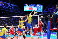 September 30, 2018 - Turin, Piedmont, Italy - Michal Kubiak of Poland against Douglas Souza (R) and Lucas Saatkamp (L) of Brazil during the final match between Brazil and Poland for the FIVB Men's World Championship 2018 at Pala Alpitour in Turin, Italy, on 30 September 2018. Poland won 3: 0 and it is confirmed world champion. (Credit Image: © Massimiliano Ferraro/NurPhoto/ZUMA Press)