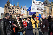 Leave supporter disagreeing with an anti Brexit protester in Westminster as the Prime Minister arrives in Brussels to request an extension to Article 50 so the UK can continue to try to agree a Brexit Withdrawal Agreement on 10th April 2019 in London, England, United Kingdom. With just two days until the UK is supposed to be leaving the European Union, the delay decision awaits.