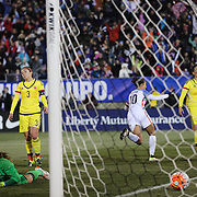 Colombian goalkeeper Catalina Perez is beaten by a shot from Carli Lloyd, USA, for the USA's fourth goal during the USA Vs Colombia, Women's International friendly football match at the Pratt & Whitney Stadium, East Hartford, Connecticut, USA. 6th April 2016. Photo Tim Clayton