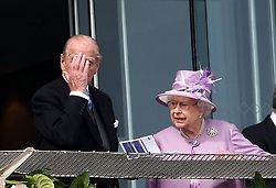 Queen Elizabeth II and the Duke of Edinburgh watch the Investec Derby race during Investec Derby Day at Epsom Downs Racecourse, Surrey. PRESS ASSOCIATION Photo. Picture date: Saturday June 7, 2014. See PA story RACING Epsom. Photo credit should read: Steve Parsons/PA Wire.