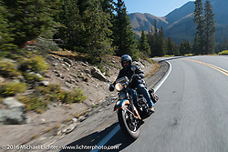 """Scott Wages, the """"Golden Ticket"""" winner, won the opportunity to ride the entire Cannonball on this 1936 Harley-Davidson Knucklehead from Carl's Cycle, shown here after crossing the Continental Divide and coming down the west side of Loveland Pass during Stage 10 (278 miles) of the Motorcycle Cannonball Cross-Country Endurance Run, which on this day ran from Golden to Grand Junction, CO., USA. Monday, September 15, 2014.  Photography ©2014 Michael Lichter."""