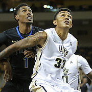 ORLANDO, FL - DECEMBER 31:  Rashad Smith #1 of the Tulsa Golden Hurricane and Shaheed Davis #33 of the UCF Knights watch for a rebound during an NCAA basketball game at the CFE Arena on December 31, 2014 in Orlando, Florida. (Photo by Alex Menendez/Getty Images) *** Local Caption *** Rashad Smith; Shaheed Davis