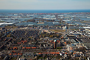 Nederland, Zuid-Holland, Westland, 20-03-2009; Naaldwijk met watertoren in de voorgrond, aan de horizon Monster en de kust van de Noordzee met Ter Heijde. Air view on the village of Naaldwijk with water tower, the glasshouses of the horticultural area and on the horizon the North Sea..Swart collectie, luchtfoto (toeslag); Swart Collection, aerial photo (additional fee required); .foto Siebe Swart / photo Siebe Swart