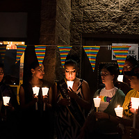 People gather in solidarity at a candlelight vigil for LGBTQ individuals who were lost this year. The vigil was part of a Diné Pride event in Window Rock on Friday.